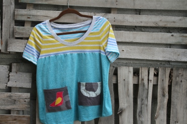 Turquoise top with peace leaf pocket small $30 BUY ME!