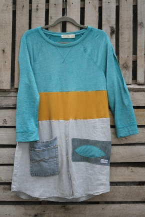 One of our all time favorite pieces! This jersey cotton mix top in Turquoise is cut to mix with a band of golden knit, finished on the bottom with a man's cotton dress shirt and unique hand sewn patch and a Denim pocket straight from our up cycled denim! Length is perfect as a casual dress or could over jeans! A lot of work went into this piece, so we hope it finds a good home! $60 Click here to purchase: BUY ME!