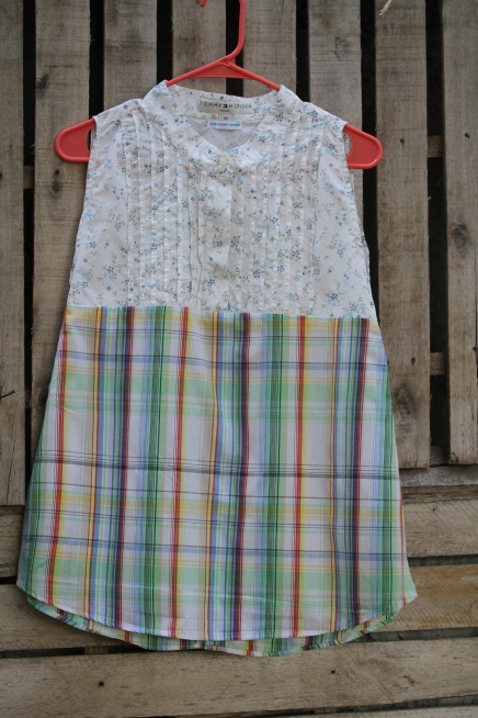 Love the soft fabric and colors in this one! White floral sleeveless top plaid muted bottom $30 BUY ME!