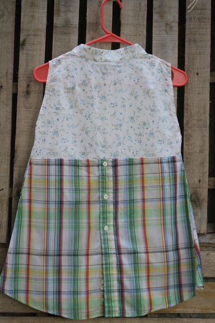 Back view of floral top plaid muted color sleeveless top Love the back buttons! $30 BUY ME!